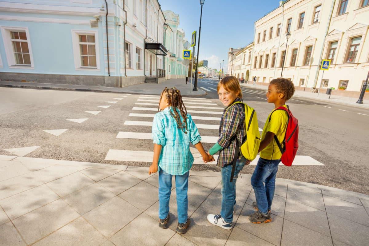 children crossing the street carefully